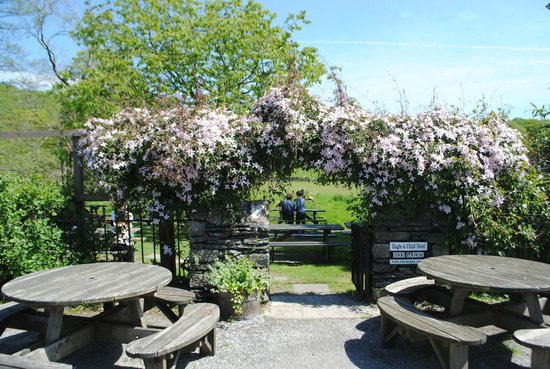 The Eagle and Child Inn: The delightful beer garden, right by the river