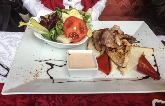 "Gruber Seerestaurant & Pension: This was a dish with ""toast"", grilled chicken, beef and pork with a salad."