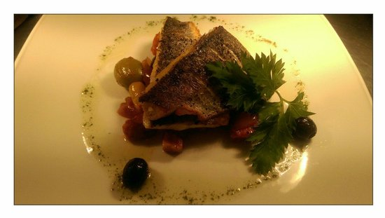 Kings Head Hotel Restaurant: Sea bass fillets with a red onion, olive, chorizo and cherry tomato ragout. ��