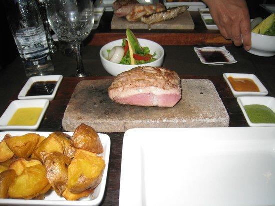 Uchu Peruvian Steakhouse: Alpaca cooked on a hot stone