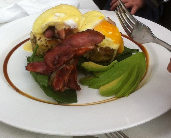 Oliver's Cafe: Eggs benedict on low gluten hash cakes with added bacon & avocado