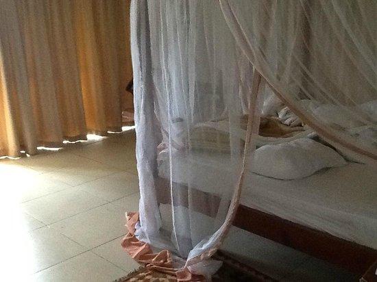 Royal Zanzibar Beach Resort: Mosquito net over bed