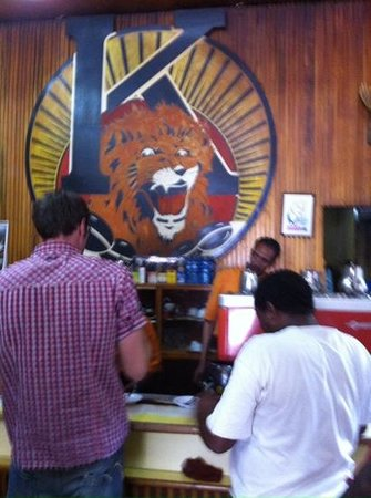 Tomoca: behind the counter roars the Lion of Judah