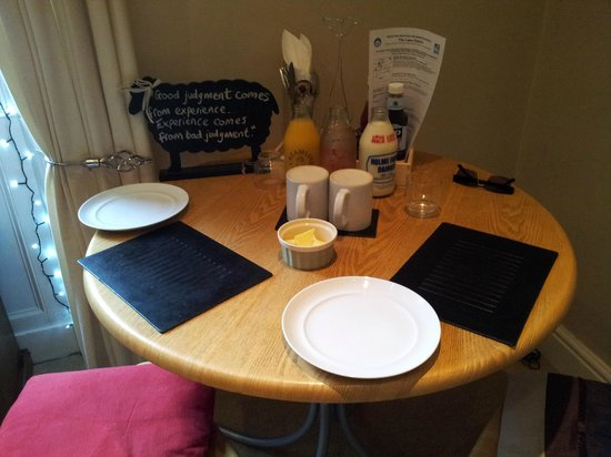 Orrest Cottage : breakfast table for two person, fresh orange juice,cold water and daily farm milk