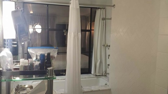 Hotel Shangri-La Santa Monica: View from bathroom (ADA) into room/suite through glass partition/window.
