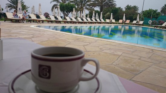 Constantinou Bros Athena Royal Beach Hotel: Coffee, black, by the pool at breakfast