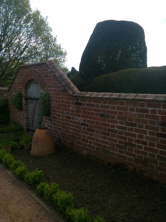 Mysterious gate and topiary - Packwood House