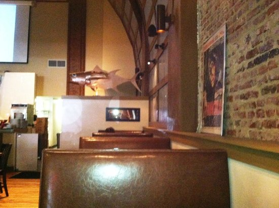 Nick's Steak and Tap House : Brick walls feature classic movie posters