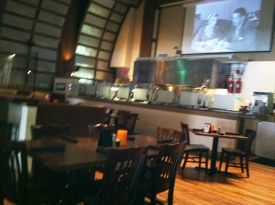 Nick's Steak and Tap House : Seating area faces screen where movies were projected.
