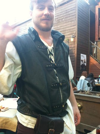 Auberge du Dragon Rouge : A waiter in a medieval costume
