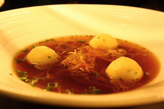 Sarah Bernhardt veal consommé with cheese gnocchi and root vegetables