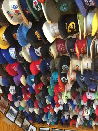 Toad River Lodge: massive hat collection in main office
