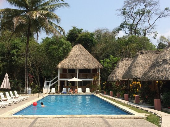 Hotel Tikal Inn: pool, with rooms #1-4 beyond, and Pool Bungalows #5-8 to the right side