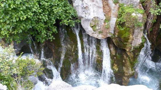 Waterfalls from the springs - Picture of Kourtaliotiko ...