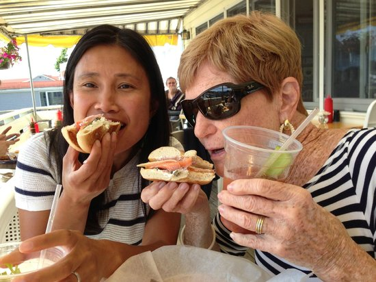 Blue Moon Cafe: Deb and Somenette enjoying their smoked salmon bagels on on gorgeous summer day