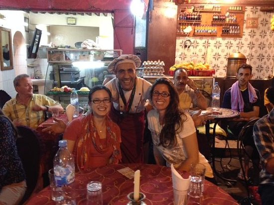 Restaurant Guenoune : My friend and I with our waiter!