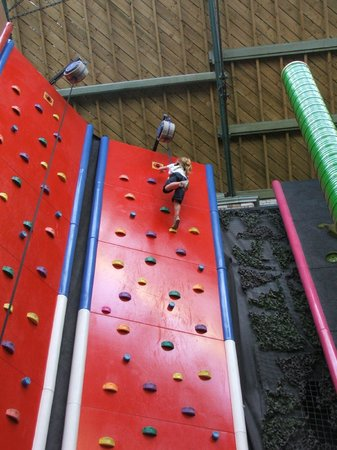 Clip 'n Climb Exeter: The birthday girl getting to the top