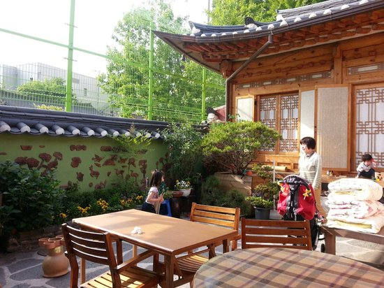 Moon Guesthouse: Courtyard, enclosed by Unyeong-dang, Pine 2, kitchen door and Pine 1 (and fencing of a school).