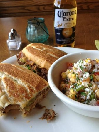 """Twisted Cuban Cafe & Bar: The """"Monster Cuban Sandwich"""" with the Garbanzo salad."""
