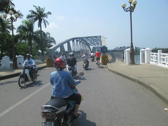 Truong Tien Bridge: my wife on the bike approaching the bridge