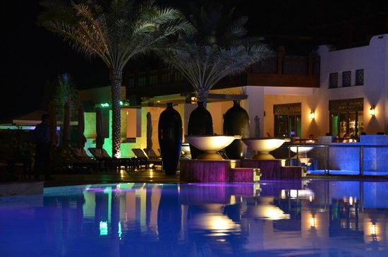 Pool area at night picture of ajman saray a luxury collection resort ajman ajman tripadvisor for Public swimming pools in ajman