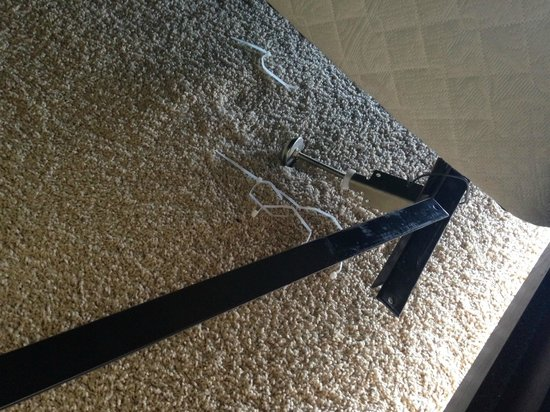 Majestic Beach Towers: the broken bed frame and zip ties they previously used, that broke...