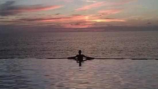 Saman Villas: Sunset by the pool