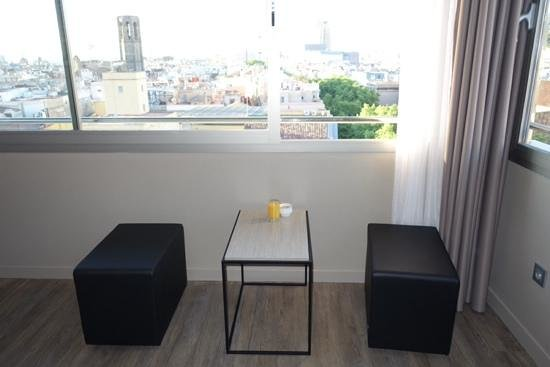 Citadines Ramblas Barcelona: Stool and side table looking at the view