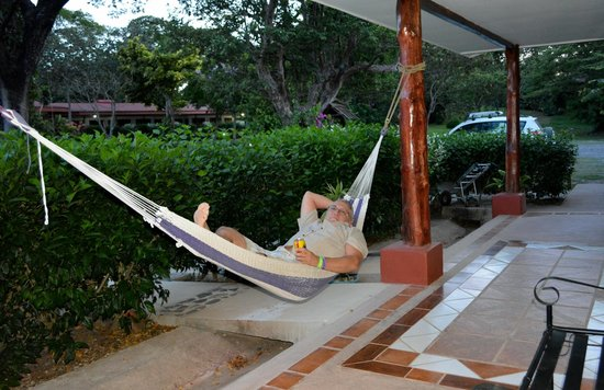 Hacienda Guachipelin: Relaxing in the hammock outside our room, beer is optional <: