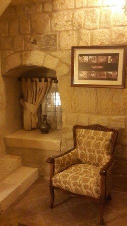 Kayakapi Premium Caves - Cappadocia: One pretty corner at dressing room, connecting bedroom and bathroom.  Classy.