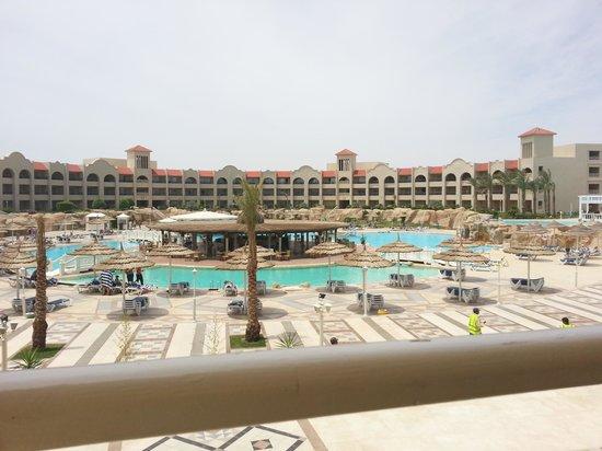 Tirana Aqua Park Resort: view of main pool/snack bar taken from upper terrace outside reception area / main bar.