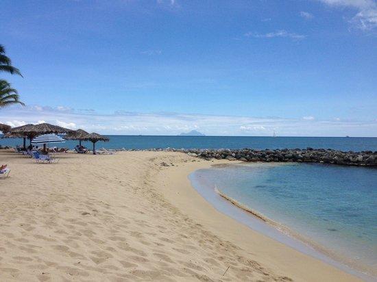Flamingo Beach Resort: On the beach, looking towards Saba