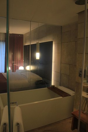 Mamilla Hotel: View of the bedroom through the bathroom wall