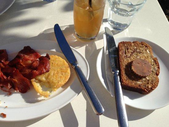 Milk & Honey: L-R: Crispy bacon, hash brown, Teza iced tea, banana bread with yumyum butter