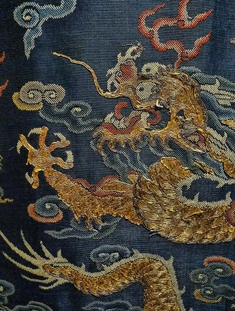 Pacific Asia Museum: Closeup of dragon woven with gold metallic thread on Qing Dynasty Jifu
