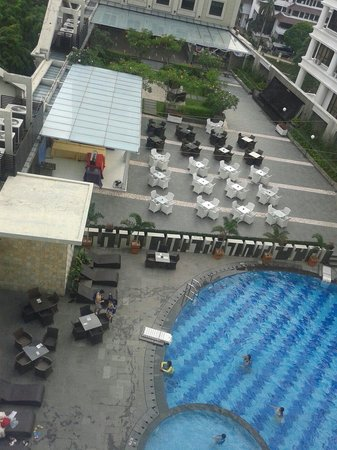 Grand Aston City Hall Hotel & Serviced Residences: View of the pool and terrace from my room.