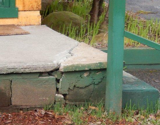 The North Woods Inn: broken walkways - not the only damaged walkway.
