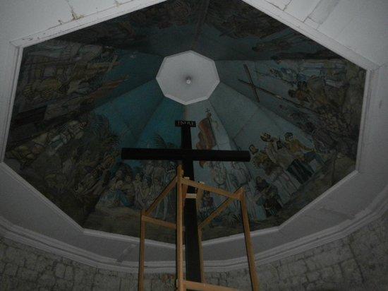 Magellan's Cross: under renovation. see the woods surrounding the cross?