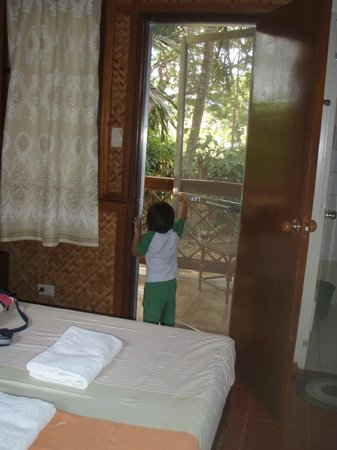 Pagdayon Traveler's Inn: my little travel buddy, Adam inspecting my room