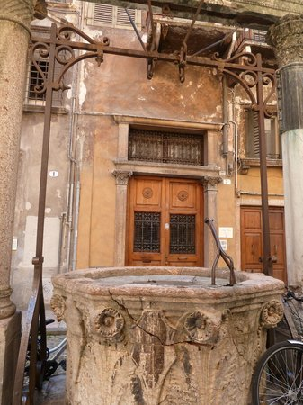 Lady Verona: Back door with the well outside