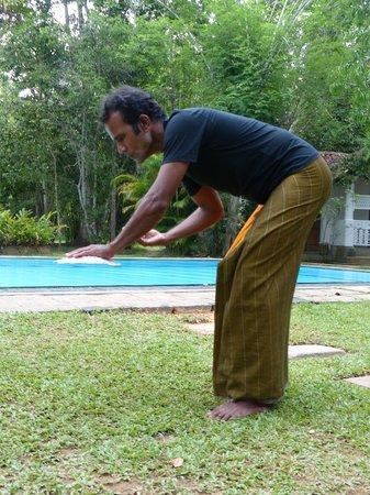 Nisala Arana : Card tricks next to the pool.