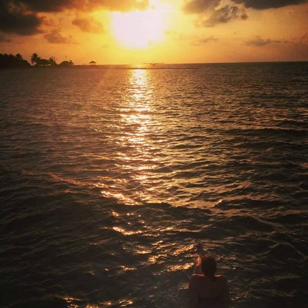 LUX* South Ari Atoll: sunset from the water villa