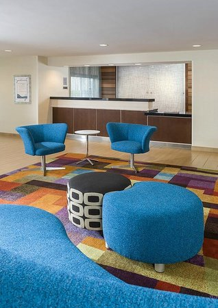 The front desk and front lobby at the Fairfield Inn & Suites Chicago Naperville/Aurora