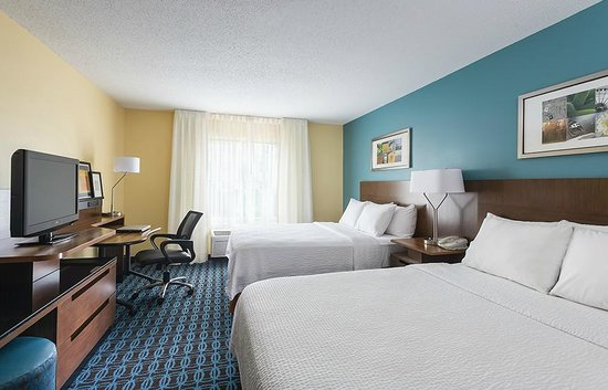 The 2 queen bed guest room at the Fairfield Inn & Suites Chicago Naperville/Aurora