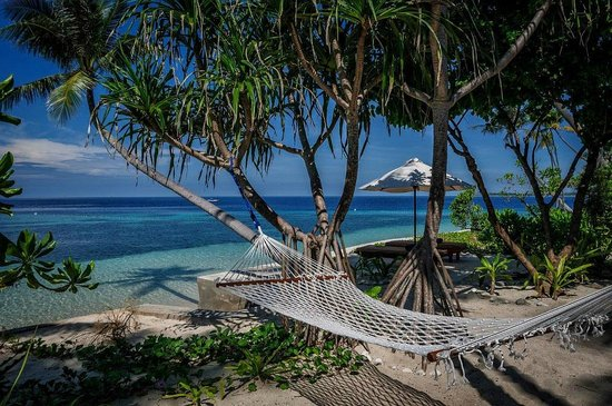 Wakatobi Dive Resort: Hammocks are located alongside each Wakatobi bungalow
