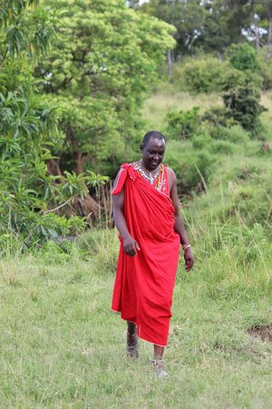 andBeyond Kichwa Tembo Tented Camp: This is Timothy, our guide and tracker.  He wore his native attire every afternoon.