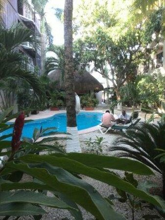 Hacienda Paradise Boutique Hotel by Xperience Hotels: Tuin met zwembad