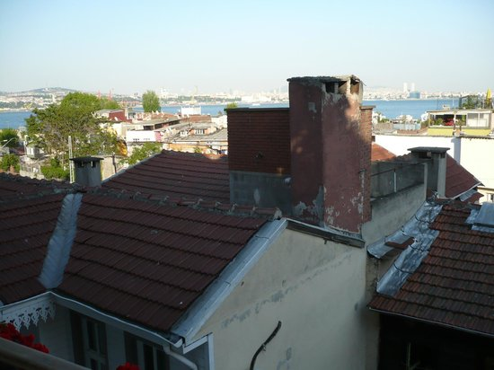 Avicenna Hotel: View across rustic roofs to the sea