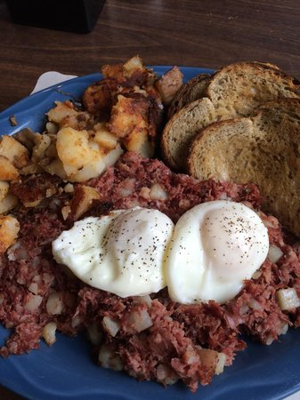 Grumpy's Restaurant: Poached eggs with corned beef hash and home fries.