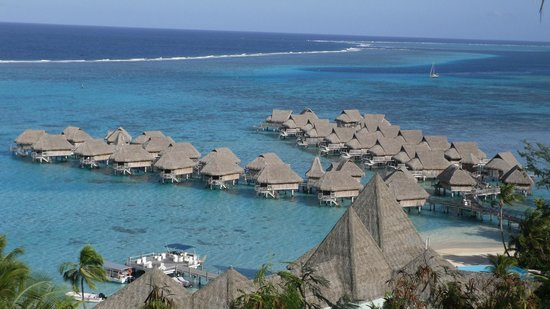 Sofitel Moorea Ia Ora Beach Resort : View of over-water units with Bar/Pure Restaurant in foreground